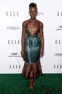 LUPITA NYONG'O STEPS OUT TO ELLE's 23rd Annual Women in Hollywood Awards WITHOUT SIGNATURE HEADWRAP