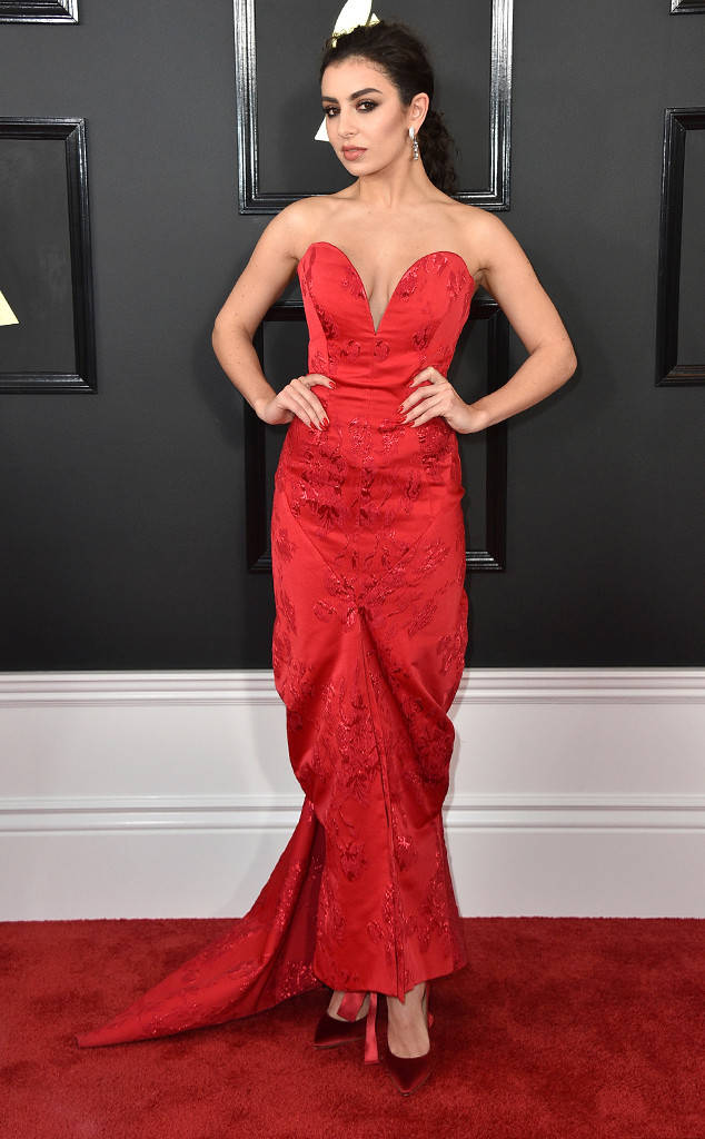 Charli XCX poses pretty in a Vivienne Westwood strapless red dress
