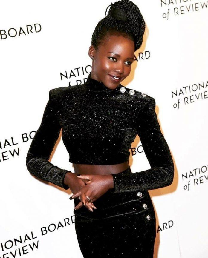 Lupita Nyong'o Flaunts Curvy Figure In Balmain Skirt