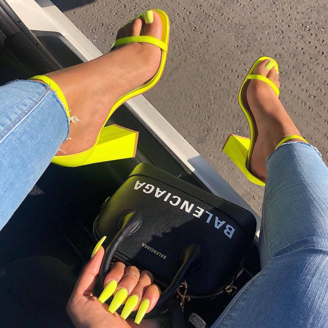 Balenciaga hand bag and yellow sandals
