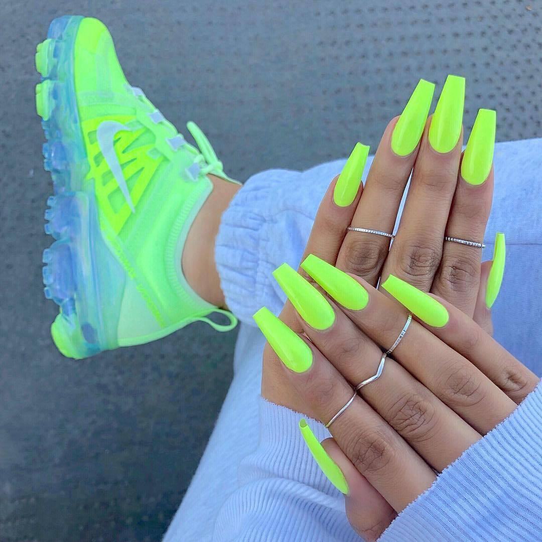 neon green Nike sneakers