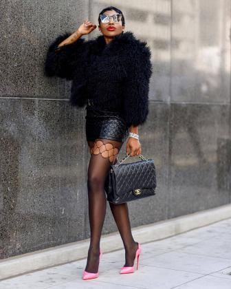 Fur coat and fishnet tights